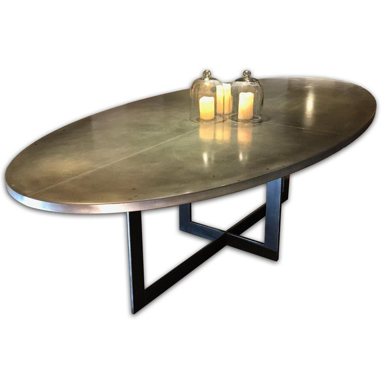 An Andrew Nebbett Designs Contemporary Oval Zinc Top Dining Table With Square Profile Edges