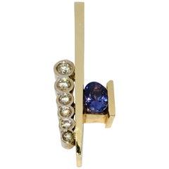 Contemporary Oval Tanzanite and Round Diamond Modern Two-Tone Gold Omega Pendant