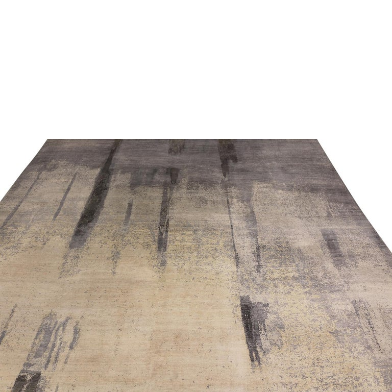 Originating from India, this contemporary design from Rug & Kilim enjoys a distinct geometric paint strokes design, hand knotted in fine wool pile and luminoux, complementary silk. The silk's natural luster creates an almost negative space in the