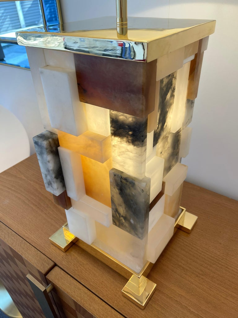 Pair of patchwork cubismi alabaster marquetry and 24k gilt metal table lamps. Intern retro lightning. Each lamps are unique in construction. Contemporary work, Few exclusive artistically production by the artist Antonio Cagianelli. A different work