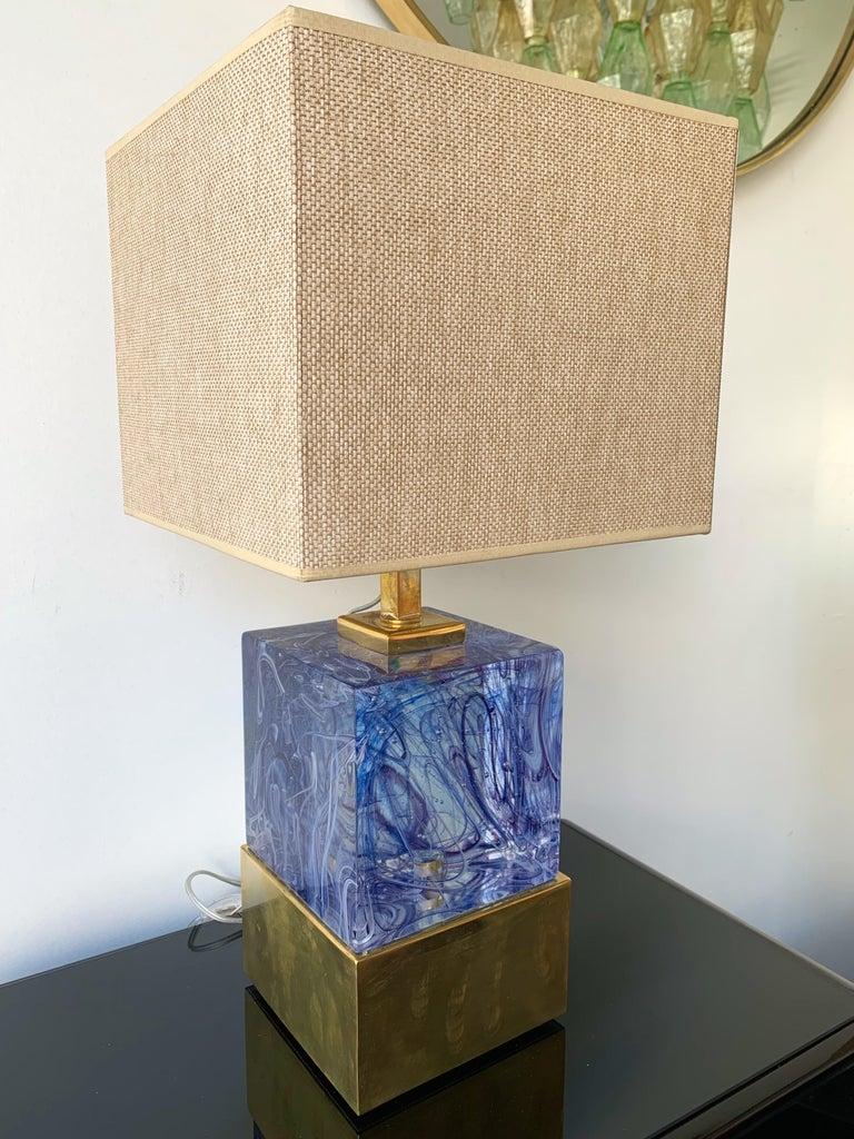 Impressive pair of lamps blue Murano pressed glass block and gold gilt brass. Height top of bulb holder 43 centimetres. Demonstration shades not include. Famous design like Carlo Aldo Nason for Mazzega, Carlo Scarpa for Venini, Vistosi, La Murrina,