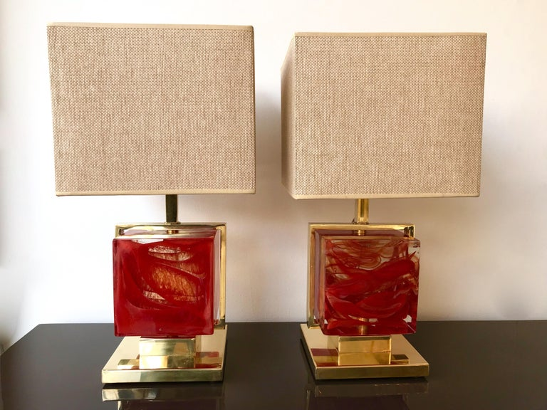 Very fresh pair of brass cage lamps with an impressive and massive blue Murano pressed glass cube. Measures: Height top of lamp 40 cms. Demonstration shades not included. In the style of Mazzega, Poliarte, Venini, Vistosi, La Murrina, Carlo Aldo