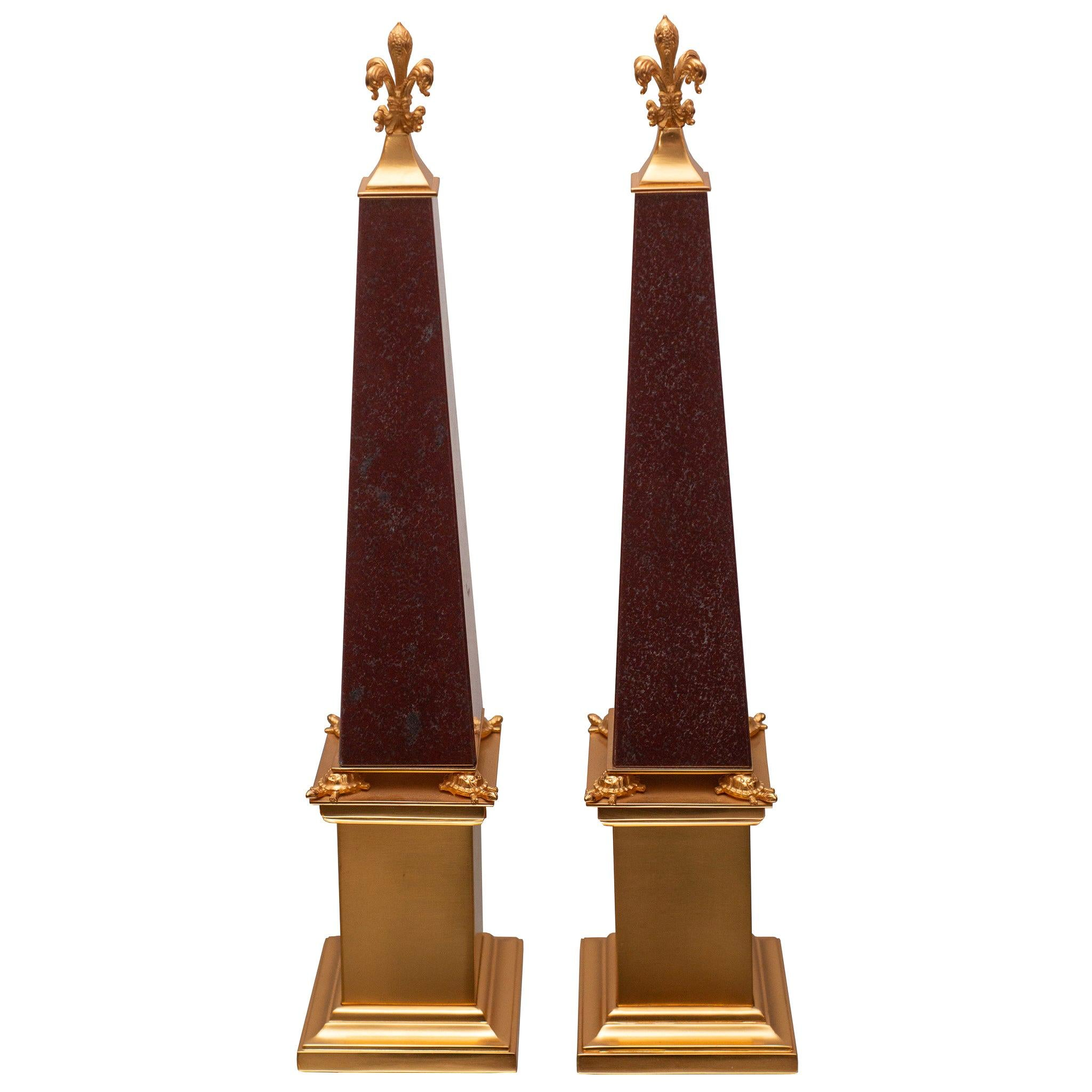 Contemporary Pair of Red Marble and Bronze Obelisks