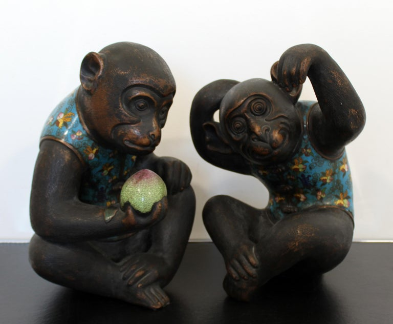 For your consideration is a fantastic pair of metal cloisonné table sculptures, of two monkeys in chinoiserie vests, by Robert Kuo. In excellent condition. The dimensions are 11
