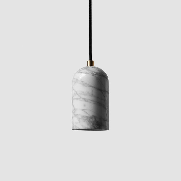 Pendant lamps 'U' by Buzao x Bentu Design.  After concrete version, let's meet the black lava stone and white marble versions!  (Sold individually)  18 cm High; 9,6 cm Diameter Wire: 2Meters Black (adjustable)  Brass (gold) or aluminum (black)