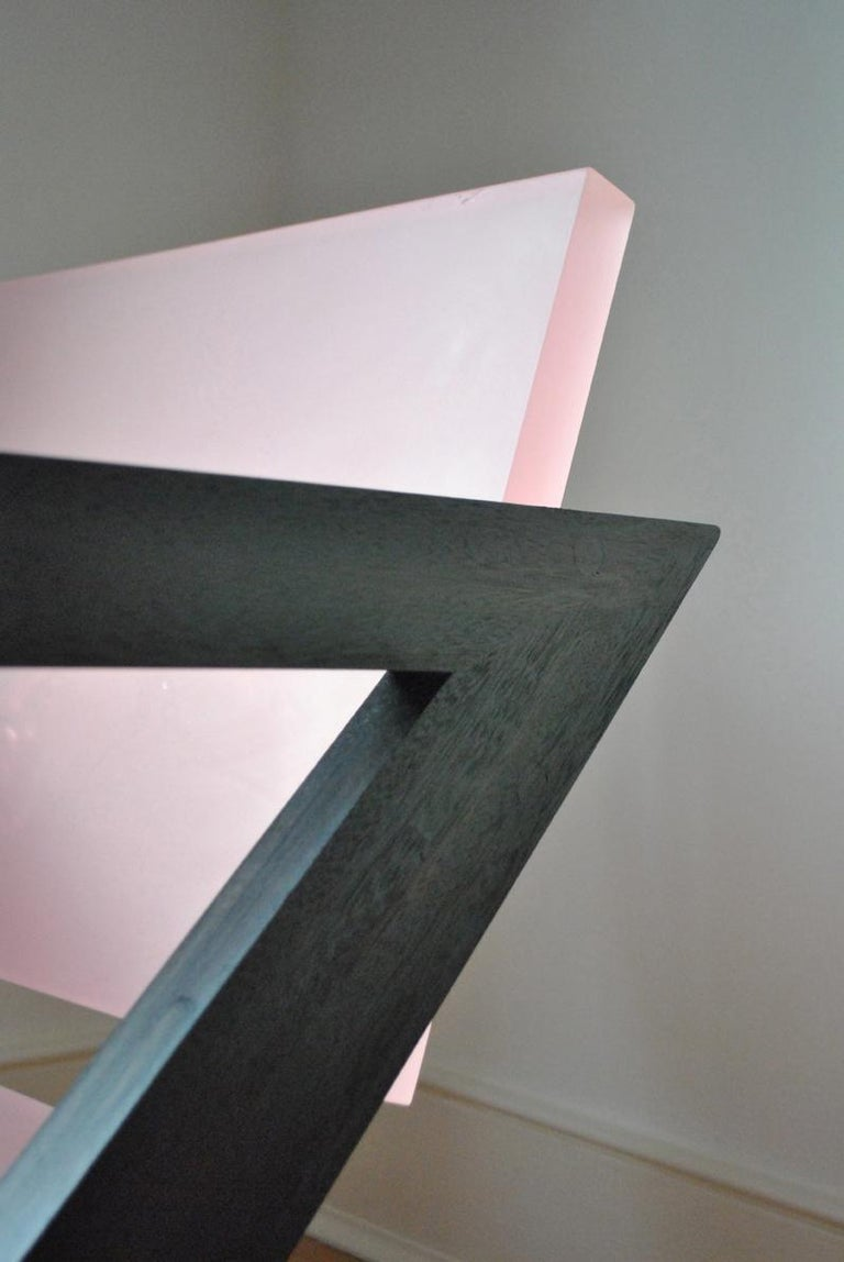The pink resin chair was inspired by the