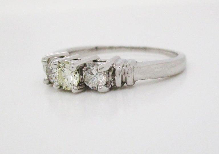 Modern Contemporary Platinum Three-Stone Diamond Engagement Ring For Sale