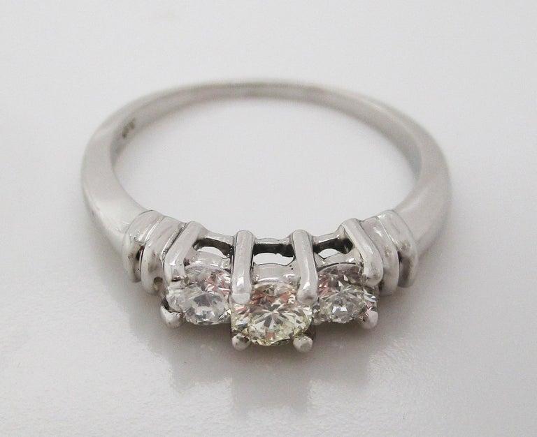 Women's or Men's Contemporary Platinum Three-Stone Diamond Engagement Ring For Sale