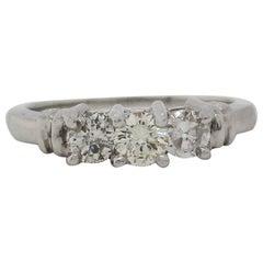 Contemporary Platinum Three-Stone Diamond Engagement Ring