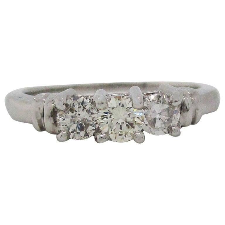 Contemporary Platinum Three-Stone Diamond Engagement Ring For Sale