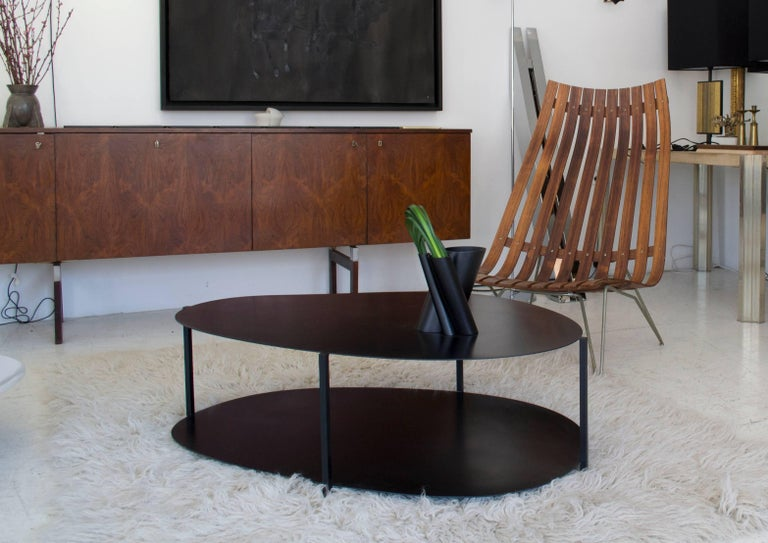 Named after the Japanese word for 'river rock' the Ishicoro contemporary coffee table is composed of two different organic shapes held together in contrast by square bars creating a delicate balance of the minimal structure, which is both formal and