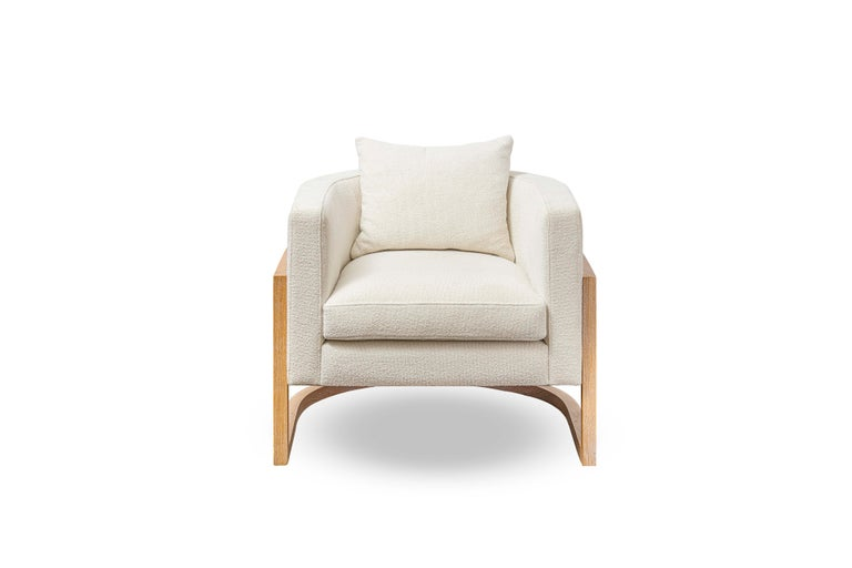 """Contemporary rattan armchair set of two. The seat is upholstered in white Bouclé and the back in woven natural cane. The solid oakwood structure provides strength and lightness to the piece. Dimensions: Width 34"""" x depth 33"""" x height 28"""" x seat"""