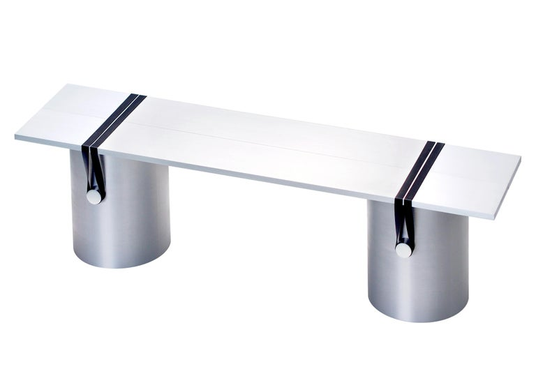 The RB03 table is composed of two brushed aluminium plates leaning onto three lightly brushed aluminum tubes; held under tension with polished aluminum cylinders and dark grey rubber bands. The table is entirely anodised so it is very resistant to