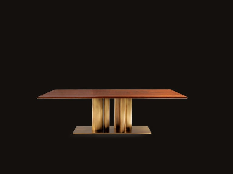 Premium solid European walnut with a really attractive, almost smokey look to it. Stainless steel tubes in brushed brass. Top and base are also offered in other finishes upon request. Also available in lacquered top and base. Handmade in