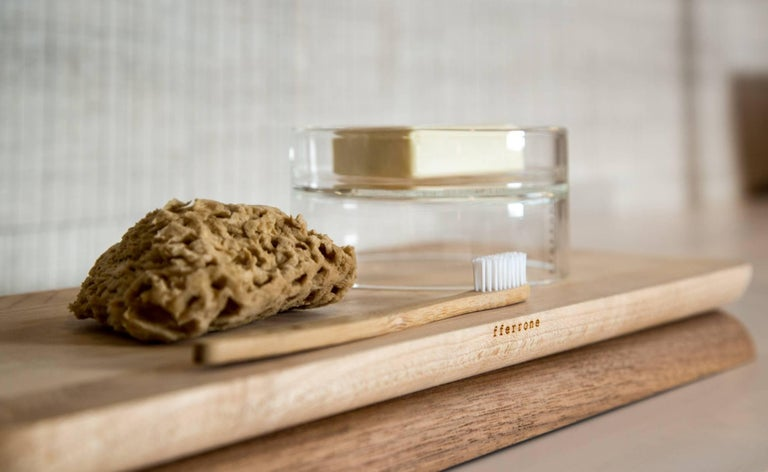 This contemporary serving board, conceived of as a centrepiece, chopping board, serving board, or tray, the Doppio is elegant when in use and when simply sitting on a table or counter. Handcrafted and finished, made of maple and walnut woods, the
