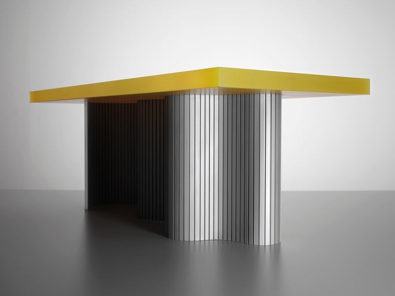 Spine table is a series of tables consisting of two components - a thin aluminium sheet captured in a cast resin surface. The series is a result of many material explorations concerned with bent forms and enhanced flexibility.   The spine of each