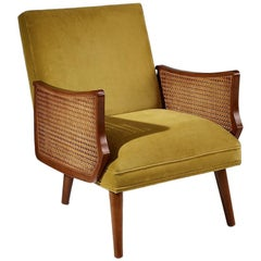 Contemporary Retro Armchair Featuring Cane Armrests