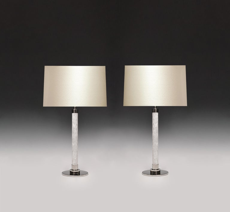 A pair of contemporary rock crystal quartz lamps with satin nickel finishes. Created by Phoenix Gallery, NYC. To the rock crystal: 19 inch H. Custom size and quantity upon request. (Lampshade not included).