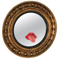 Contemporary Round Giltwood Mirror with Sticking Out Tongue Sculpture