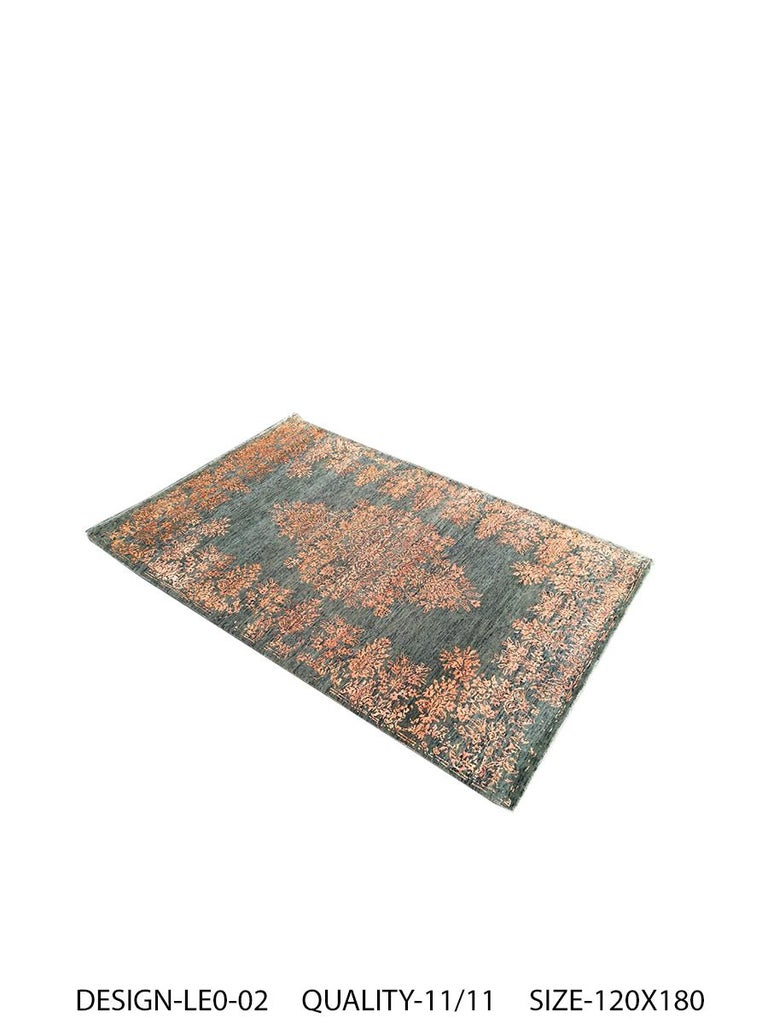 A new addition to the handmade rugs by Rug & Kilim, this 4' x 6' contemporary rug is hand knotted in a unique, proprietary blend of quality wool and silk, the natural luster of the latter bringing out transitional hues of orange and green with a