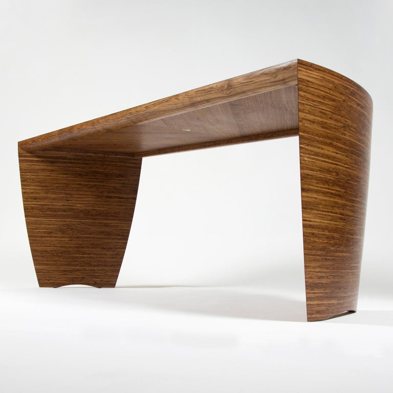 The contemporary sculptural 'Radiant' desk by Edward Johnson forms part of his Murano Collection. The pieces in this collection all utilise Edward Johnson's unique 'Murano' veneers that have been developed and produced in his workshop.  The desk
