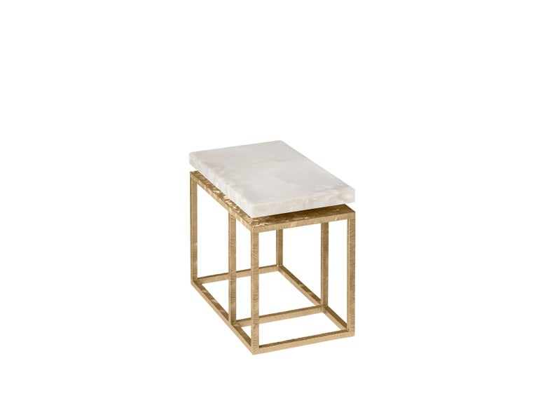 Lineup coffee table is characterized by a metal structure with a linear design. The skillful manual method of metal engraving is inspired by the working techniques of Italian premium class jewelry. The essential and rigorous metal structure creates