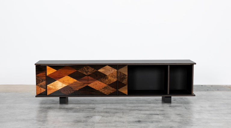 Sideboard by contemporary German artist Johannes Hock. The sliding doors of this unique piece are made of diamond shaped veneers of various origin such as maple, ebony, yew, walnut, rosewood, Makassar, poplar, oak and more. The body is made of black