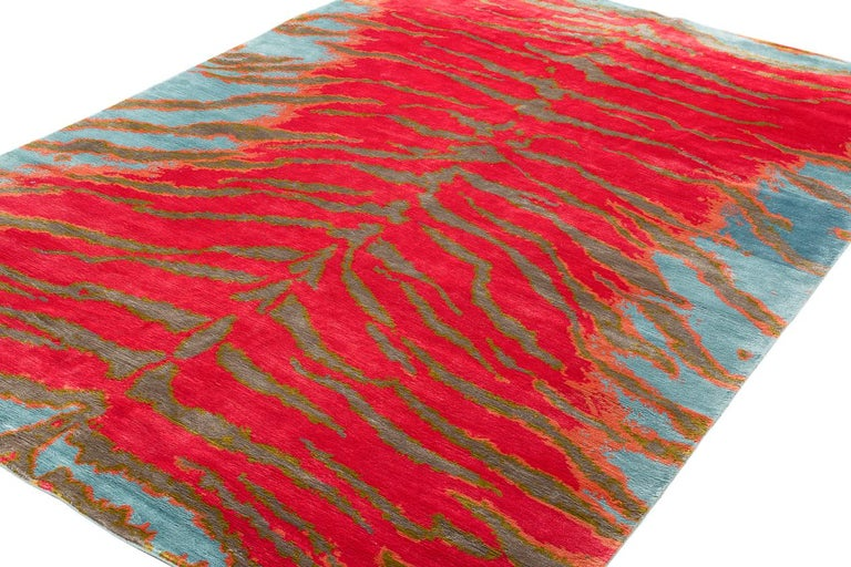 Tiger is a Joseph Carini carpets signature design that has been translated into countless color-ways. The Tiger Tropics design is shown in vibrant pinks and blues done in all natural dyes. Original design by Joseph Carini.