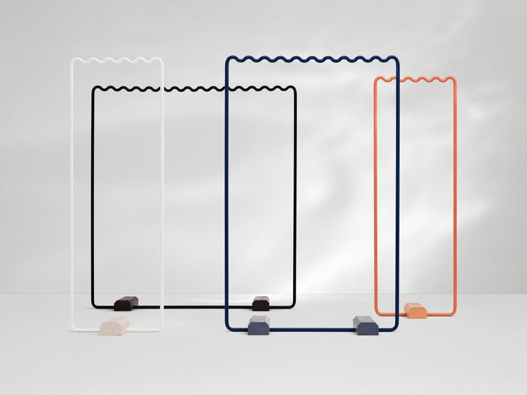 Sine collection is a hanging system for clothes inspired by the regular Tempo of sine wave. Studio EO are launching this system that creates evenly spaced hanging points to give the clothes a more organized presentation.  The coat racks are