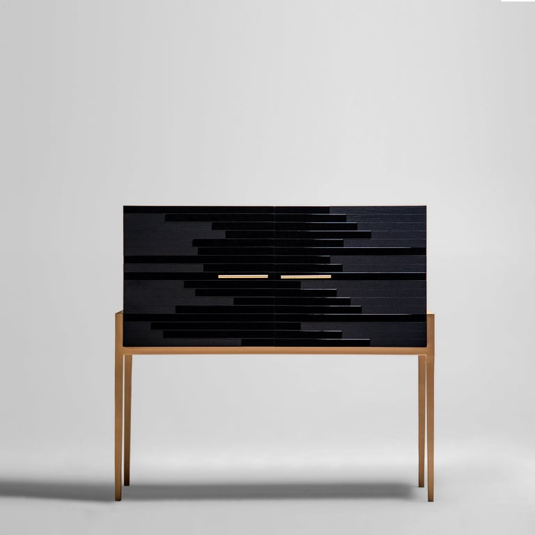 Storage cabinet with doors designed by Larissa Batista   Modern cabinet featuring unique mixed black lacquer and black oak. Social media hit high-end furniture by designer Larissa Batista, a cabinet as daring as it is elegant. This piece plays
