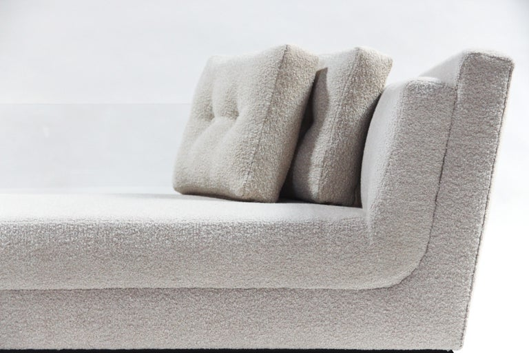 The view sofa, with its clear Lucite back panel, will make a bold statement without demanding all the attention. It is equally suited for placement in the middle of a room or in front of a large picture window where it will never block the