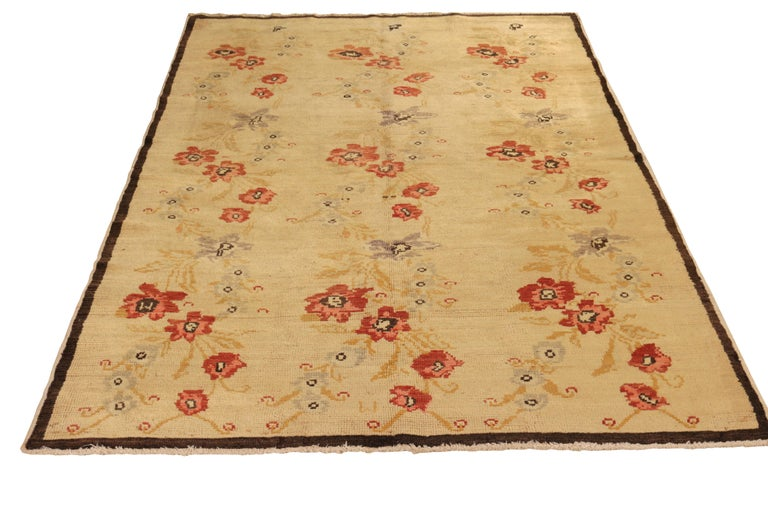Drawing inspiration from Anatolian Sparta rug design, this contemporary rug was hand knotted in wool capturing the vintage Sparta rug sensibilities in an elegant approach to modern florals with beige and red tones. Within this piece additional
