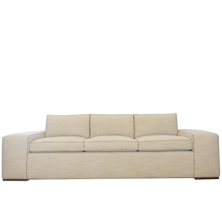 Contemporary square arm sofa with faux leather welting. Arm is 13