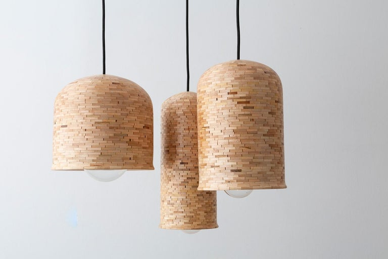 Oiled Contemporary Stacked Skinny Bell Pendant Light by Richard Haining For Sale