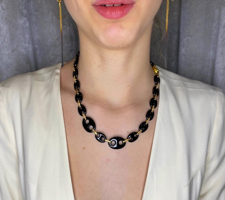 """From the """"24/7 """"collection this statement chain necklace is made in 18 Karats yellow gold with nautical onyx links. The collection evokes the designers' love for the sea and sailing. As San Sebastián natives, a seaside city, with a harbor, it was"""