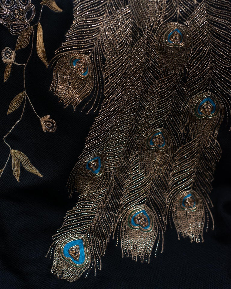 Just landed: Statement Peacock wool throw blankets, ornately hand embroidered with metal thread and fine beading. Comprised of 100% merino wool, these blankets are as soft as they are luxurious. Embroidered on one side and raw edge finish.