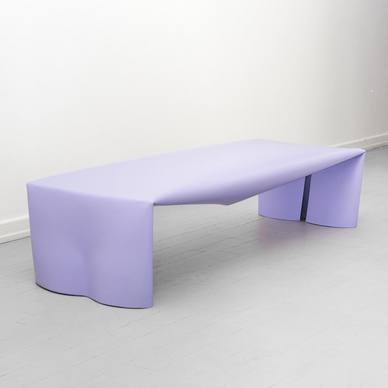 The steel bench is a monolithic steel form created from a combination of a few simple actions. Working with a bespoke metal fabrication company, a flat sheet of steel is manipulated in three operations: it is rolled into a tube, pressed flat and the