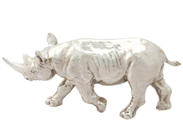 A fine contemporary cast English sterling silver model of a Rhinoceros; part of our animal silverware collection.  This fine contemporary cast sterling silver ornament has been realistically modelled in the form of a rhinoceros.  This silver