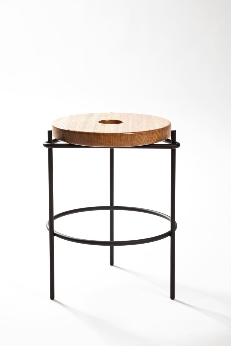 This versatile minimalist stool in solid Brazilian wood