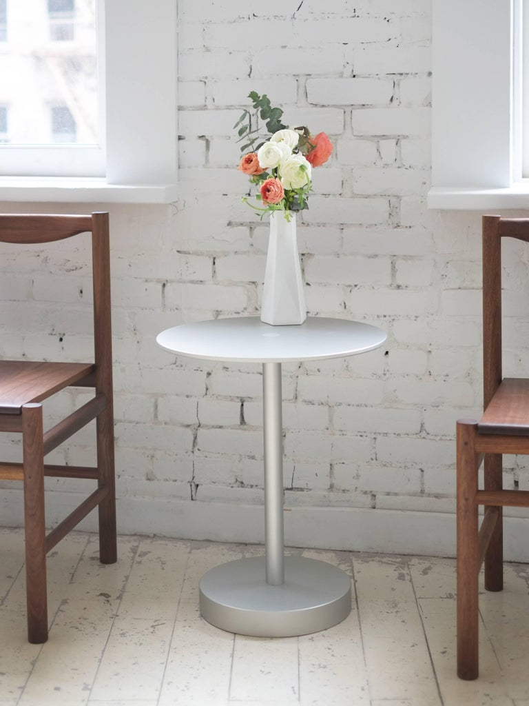 "This refreshing, contemporary approach to a classic side table design features a surface connection detail centered in the precision milled 3/8"" plate top. The robust 2"" thick bottom is connected via a 1 1/2"" solid machined stem. The perfect"