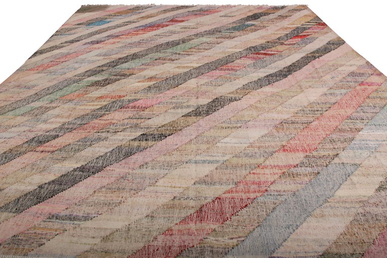 Sporting an eccentric play of soothing and rustic hues in the field, this contemporary Kilim represents a selection of distinct new patterns joining Rug & Kilim's new and modern collection, uniquely handwoven from the yarns of Classic textiles and