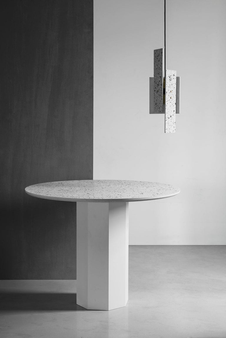 'GONG' is a dining table made of terrazzo and steel. by Bentu Design  Indoor or outdoor use. Dimensions: Ø100cm x H75 cm   Bentu Design's furniture derives its uniqueness from the simplicity of its forms and its materials. Designed and