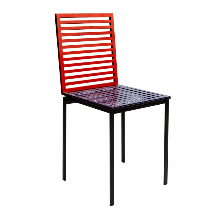 The 'Tanit Classic' series features backs and seats of aluminum. The panels are variously perforated, thus creating an interesting geometric effect. Seats and backs feature a chequered 'full & empty' fretwork and a horizontal strip 'full & empty'