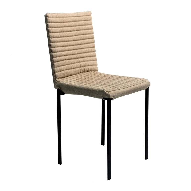 The 'Tanit Soft' chairs are available with an option that makes them unique objects in terms of richness and comfort: an upholstered and quilted cover of various colors that is put on the frame and fastened with a Velcro strap.  The upholstered