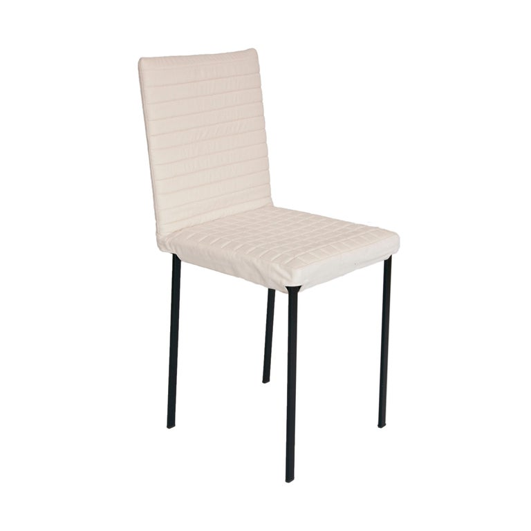 The 'Tanit Soft' chairs are available with an option that makes them unique objects in terms of richness and comfort: an upholstered and quilted cover of various colors that is put on the frame and fastened with a Velcro strap.