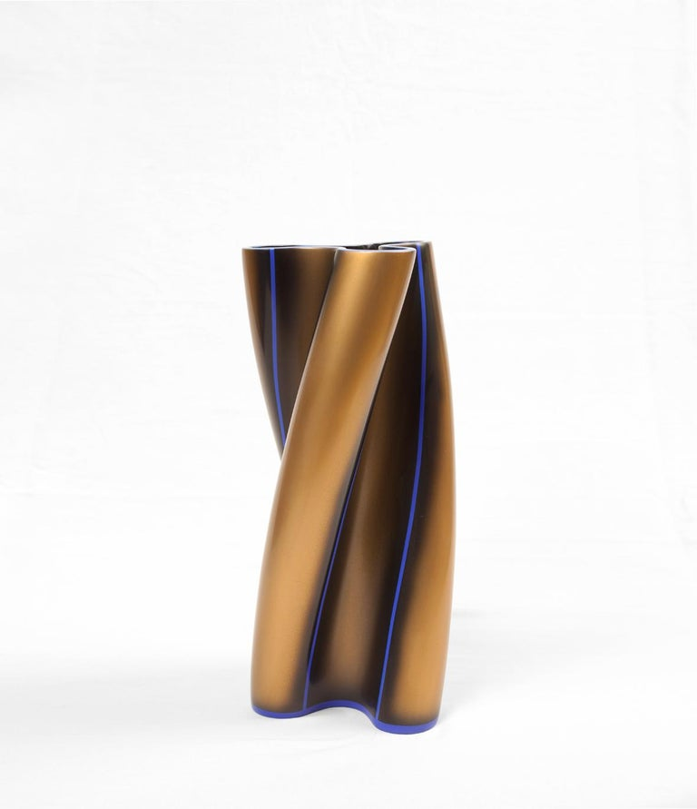 Contemporary lacquered vase by Golem of Italy, this is a decorated version of the twin vessel selected in 2016 for the International Ceramics Biennale in Taipei, the simplified design features three sinuous lobes and a horizontal opening at top. The