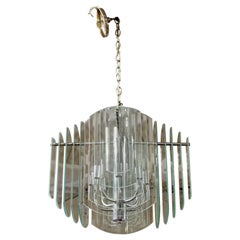 Contemporary Tiered Glass and Chrome Chandelier by Luminaire, 1980s