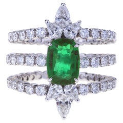 Contemporary Triple Ring with Diamonds and Emerald Cushion Cut