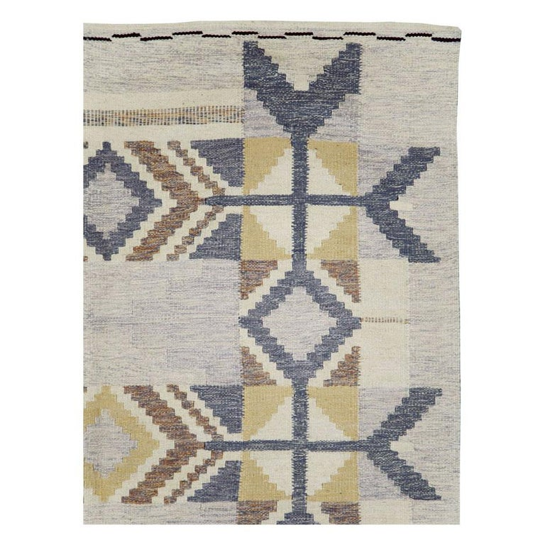A modern Turkish flat-weave accent rug handmade during the 21st century. The design and weave are inspired by vintage Swedish Kilim rugs from the mid-20th century period.