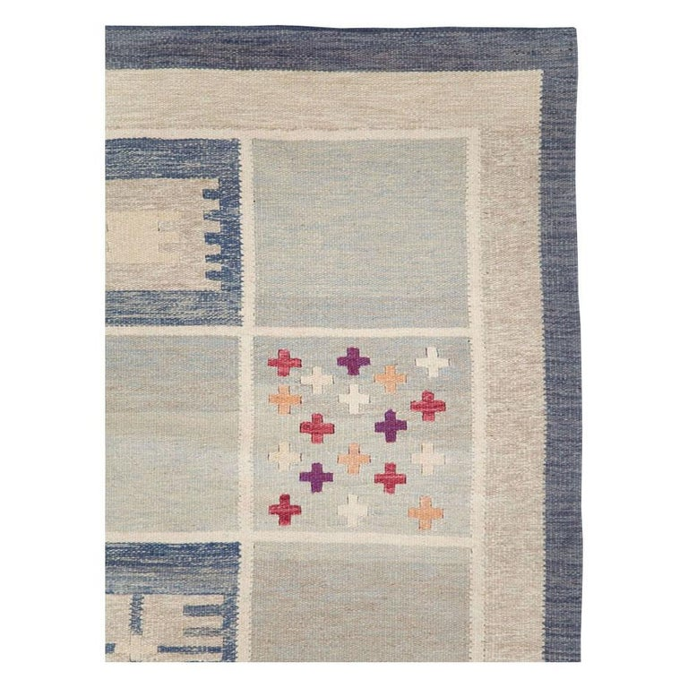 A modern Turkish flat-weave accent rug handmade during the 21st century. The design and weave are inspired by vintage Swedish Kilim rugs from the mid-20th century period.  Measures: 5' 9